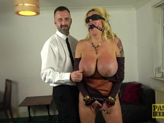 A submissive mom with huge tits does it all for her young master