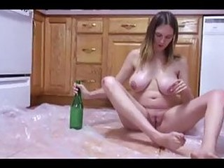Busty plumper got so horny, that she took a bottle and started masturbating in the kitchen